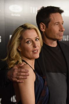 "Gillian Anderson Photos Photos - Actors Gillian Anderson and David Duchovny attend the premiere of Fox's ""The X-Files"" at California Science Center on January 12, 2016 in Los Angeles, California. - Premiere of Fox's 'The X-Files' - Red Carpet"