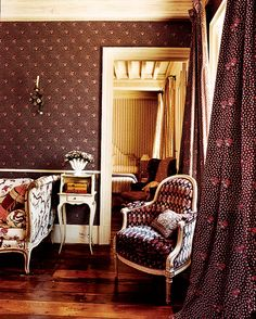 In the guest room of Janet Wolfson de Botton's magnificent South of France estate, a Louis XVI bergère matches the palette of the wallpaper and curtains.