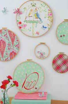 fabric displayed in embroidery hoops---I did this with 3 different sized hoops with fabric leftover from making baby's blanket and it took about 5 minutes and is super cute! And cheap!!!