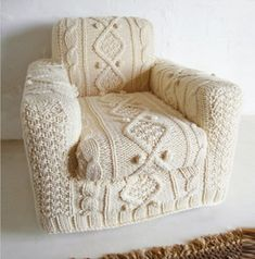 hand knitted cream aran armchair slip cover via Etsy. This could have me buying an armchair.