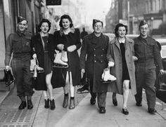 8th December 1940: British soldiers and their girl friends off for a day's skating at a rink in London.