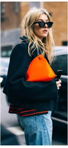 Camille Charriere orange bag and Celine shades.