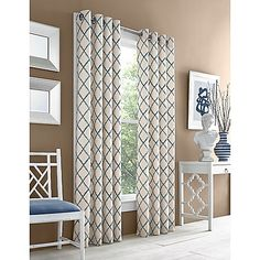 Dress up your window with the stylish Adorn Grommet Top Embroidered Window Curtain Panel from J. Queen New York. Its embroidered zigzag pattern blends to form a beautiful allover diamond design that complements a relaxed or modern setting.