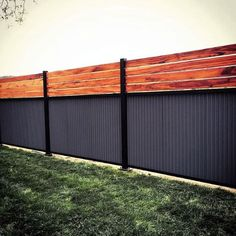 There are three wood privacy fence designs that rank among the top. These include the lattice-top, shadowbox and your basic privacy fence. Cheap Privacy Fence, Privacy Fence Designs, Backyard Privacy, Backyard Fences, Fenced In Yard, Garden Fences, Yard Fencing, Backyard Landscaping, Fenced In Backyard Ideas