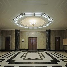 Courtroom lobby, James T. Foley U.S. Post Office and Courthouse, Albany, New York. Built in 1931-1932. Art Deco style. Five-story building with 8' high sculptured marble frieze continuously wraps around the primary elevations.