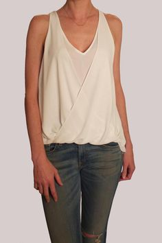 """Draped crossover panels give an effortless, fluid look to this Elizabeth and James blouse.  Pair with dark skinnies and heels for a night out.   Model is in size S. Model is 5'10""""/ bust, 33""""/ waist, 26""""/ hip, 36"""" Tiana Top by Elizabeth & James. Clothing - Tops - Tees & Tanks Clothing - Tops - Blouses & Shirts Clothing - Tops - Sleeveless Canada"""