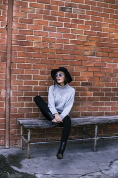 Mafalda Castro is looking effortlessly cool in this wide brimmed fedora and marl grey knit turtleneck. Pair this look with some retro sunglasses and leather boots to recreate Mafalda's cute style. Blouse: Hiippie Chic, Boots: Zara, Jeans: Cheap Monday, Hat: Stradivarius, Necklaces: Lovely Breeze.