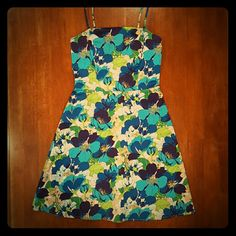Floral sundress White background with a vibrant 70's-feel floral pattern in hues of blue, turquoise, lime and Kelly green. Spaghetti straps. Hidden back zipper. Dress has a hint of stretch (3% spandex) Alyn Paige Dresses Strapless