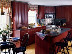 LOVE THIS KITCHEN:   Guide to Creating a Country Kitchen: Choose printed fabrics in toile, gingham or stripes for your window treatments. Design by Sue Adams. From DIYnetwork.com