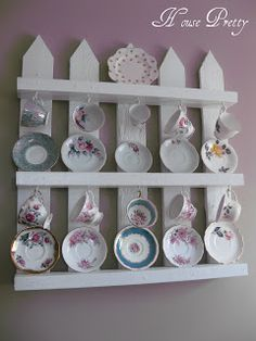 Tea cup &saucer / china display... Wonder how this might look from pallets/barnwood?