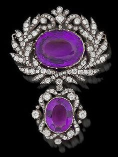 A Georgian amethyst and diamond brooch, circa 1820. The large oval mixed-cut amethyst, within a stylised laurel wreath border of old brilliant and rose-cut diamonds, suspending a detachable drop of similarly set amethyst and diamonds, mounted in silver and gold. #Georgian #antique #brooch