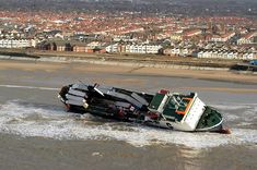 31 January 2018 is the anniversary of the Riverdance Shipwreck at Anchorsholme, between Cleveleys and Blackpool. See photos of the boat on the beach, the salvage operation, and the Riverdance spectacle. Blackpool Beach, Laying On The Beach, The Last Ship, Irish Sea, Seaside Towns, Southport, Shipwreck, Public Art, Natural Disasters