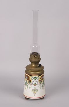 Art Nouveau Oil Lamp This is an Art Nouveau Oil Lamp with a Sarreguemines ceramic reservoir with painted arabesque motifs and the origina...