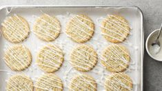 If you like lemon, you're going to love these cookies! Your favorite sugar cookies get transformed with poppy seed and lemon, and the sweet, citrusy glaze drizzled on top is impossible to resist. Spring Desserts, Desserts To Make, Lemon Desserts, Lemon Recipes, Cookie Desserts, Cookie Recipes, Delicious Desserts, Dessert Recipes, Spring Treats