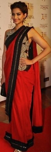 Sonam Kapoor is the ultimate fashionista! I love the blouse with a fairly simple sari + her classic hairstyle
