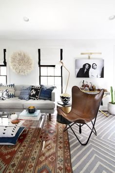 Western style living room with Navajo textiles, leather chair and natural wall art