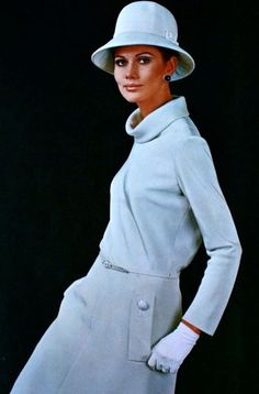 1967 Maud Adams is wearing Nina Ricci, Vogue white wool suit dress hat gloves vintage fashion style 60s 70s color photo print ad model magazine designer