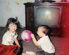 http://paranormal.about.com, says: When my parents took this picture of my brother and me, they could not see that face in the TV at all, so we were all very shocked when we got the picture developed. And the TV was not on.