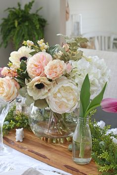 Decorating with faux flowers is a beautiful way to bring springtime in your home. Mix them with fresh flowers for a more realistic touch.