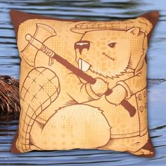 The Beavers Pillow by Jeremy Fish. This beaver doesn't give a dam unless we're talking about stepping up your pillow game. Available online and in store. @mrjeremyfish #jeremyfish #superfishal #shopUP #UpperPlayground #beavers #dam