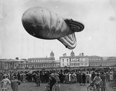 Crowds watching a balloon rising during a demonstration in Greenwich Park. 1938