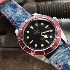 MiLTAT Zizz Collection Distressed Denim Watch Strap Red Wax Hand Stitching demo on Tudor Submariner Heritage Black Bay Tudor Black Bay Red, Tudor Heritage Black Bay, Tudor Submariner, Tourbillon Watch, Rolex Tudor, Leather Watch Bands, Fashion Watches, Watches For Men, Pure Products
