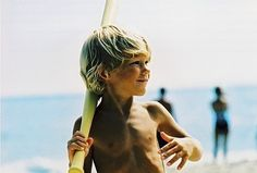 Blond, cute, little surf boy