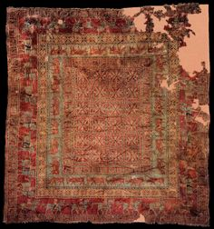The Pazyryk Carpet, the oldest known surviving carpet in the world, 4th century B.C. Scythian. Hermitage Museum St. Petersburg.