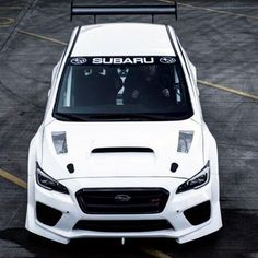 Subaru has teamed up with Prodrive to build the track-ready WRX STI that set a new record on the Isle of Man course. The purpose-built WRX STI was driven by Mark Higgins, an experienced pilot who has been racing Subarus for years. Subaru Impreza, Subaru Wrx Sti 2016, Subaru Cars, Rally Car, Car Car, Fuji Heavy Industries, Auto Retro, Car Mods, Modified Cars