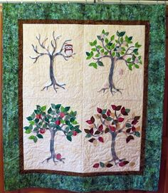 I LIKE THE ADDITION OF THE OWL TO THE WINTER TREE. Gorgeous four seasons quilt...