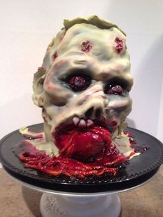 Zombie Head     Zombie Head This cake was for a Walking Dead themed surprise birthday party. I do imagine the birthday girl was a bit surprised by this... #hanging-zombie #halloween #living-dead #cakecentral