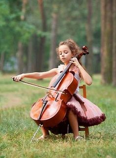 Pinner sez: ♫♪ Music ♪♫ little girl play cello And she looks a little like me when I was that age! LOL.