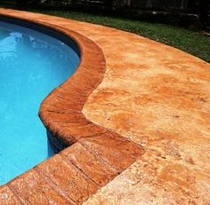 What's nice about this pool deck is its sun stamped pattern, its warm color and the fact that it is slip-resistant. Concrete Coating Specialists, Inc. can bring this to your home too! Call (619) 443-2318	 or visit http://www.sandiegodecorativeconcrete.com/ for more information.  #homeimprovement #pooldesign #decorative concrete