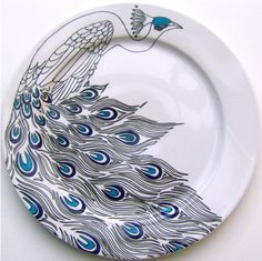 peacock plate - I think these would look good with my brown and cream table linens - need setting for 8