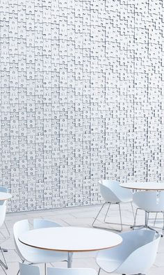 Handmade tiles can be colour coordinated and customized re. shape, texture, pattern, etc. by ceramic design studios