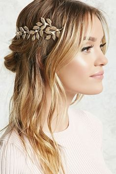 A high-polish headband featuring an ornate etched leaf design with faux pearl studs.