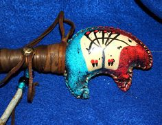"""Native American BEAR Rattle Hand Painted 15"""" Antiqued Feathers This rattle has a nice sharp sound & its handle is wrapped in dark brown leather. it is decorated with stone arrowheads, glass crow beads & featthers. Native American made. #regalia #nativeamerican #rattle"""