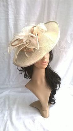 Beautiful Turned up brim Ivory & Gold Sinamay Feather Hatinator on a Headband..feathers