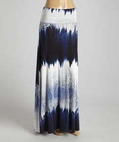 Go from a stroll to a strut in this sweeping blue and white tie-dye maxi with paisley flourishes. Silken fabric with a slight stretch ensures a comfortable fit.  Size note: This item runs small. Please refer to the size chart.