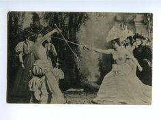 Photographic postcards and, toward the end of the 19th century, stereoscopic views of sword-wielding female nudes were a logical continuation of artistic conventions expressed in drawing, painting, and sculpture. Until the late 19th century, however, women's roles in affairs of honor were restricted to that of spoilsport—breaking up a fight before it had begun—It was only in the late 1800′s that the women started taking a more pro-active role in artistic dueling. At least on paper.
