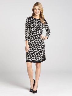 Slip into this gorgeous Spring day leaf print block dress. The geometric pattern is striking at the eye's first glace. It features 3/4 sleeves and a lovely scoop neck. We especially love the parallel trim along the bottom and would pair wit...3010101-0748