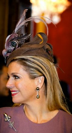 Queen Maxima's accessories details during The Dutch Royal couple visits to Italy at Palazzo Chigi in Rome, Italy, 23.01.14