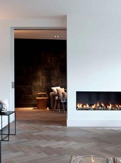 Double sided fireplace with two chairs in sitting room, a faux cowhide rug and a glass table. Unless they tell me a gas fireplace is impossible. Gotta have a modern firebox in the house! Home Fireplace, Modern Fireplace, Fireplace Design, Fireplaces, Simple Fireplace, Interior Architecture, Interior And Exterior, Interior Design, Water House