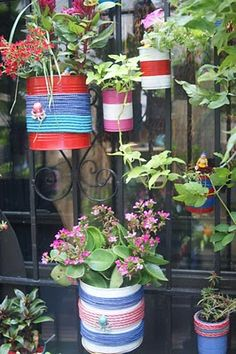With painted tin cans wrapped with pastel rope, my pal Heather Kerr created a wall of nautical-inspired hanging planters on her teeny-tiny . Diy Crafts Love, Tin Can Crafts, Kids Crafts, Painted Tin Cans, Paint Cans, Recycle Cans, Reuse, Mason Jar Crafts, Bottle Crafts