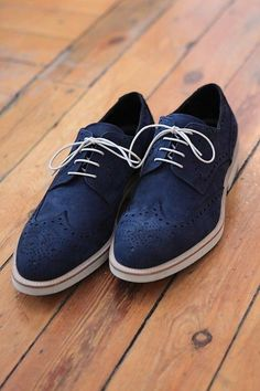 Dark Blue Brogues which can be styled with Blue Ripped Denim Jeans and a Tshirt