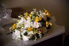 Bouquet with gardenia flower, yellow freesia, lilies of the valley and greenery. Event Planner : Happening.