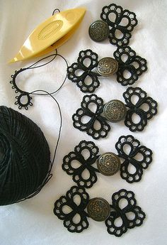 Tatted frog closures by Yarnplayer on Flickr: My original design. Tatted in Lizbeth thread size 20. Each set measures a little over 1 by 2 inches. The shank button is about 5/8 inch.