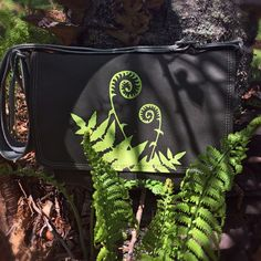 Handcrafted canvas messenger bag with Fiddlehead Fern print and Entomology print lining.
