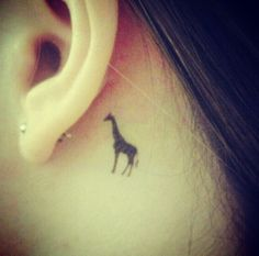 Giraffe tattoo  But back of the neck