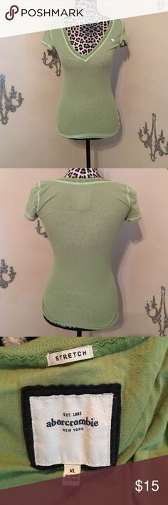 Abercrombie stretch T-shirt Lace embellished v-neck stretch tee by Abercrombie. XL in Abercrombie language means small-medium in real life!!! Abercrombie & Fitch Tops Tees - Short Sleeve